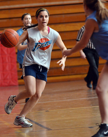 Peabody: Guard Sabrina Rizzo sets up a play with her Peabody Basketball Association team.  photo by Mark Teiwes / Salem News