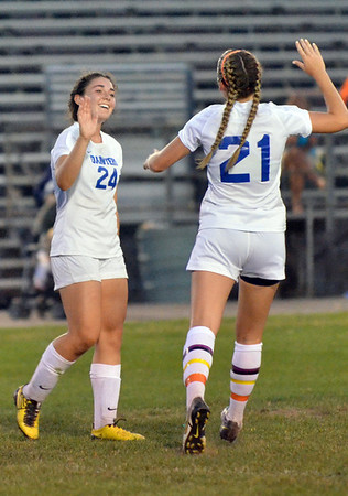 Danvers: Danvers player Kylie Plaza, left, celebrates her goal with Kristin Yost who also scored in the first half in their 2-0 win over North Andover. photo by Mark Teiwes / Salem News