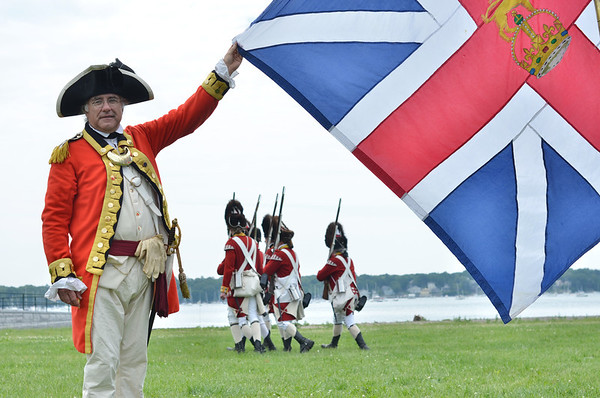 "Salem: Chris Kone of Easton plays Captain Lt Colonel of ""His Majesty's First Regiment of the foot guards part of the weekend's British reenactment units encamped on Derby Wharf. photo by Mark Teiwes / Salem News"