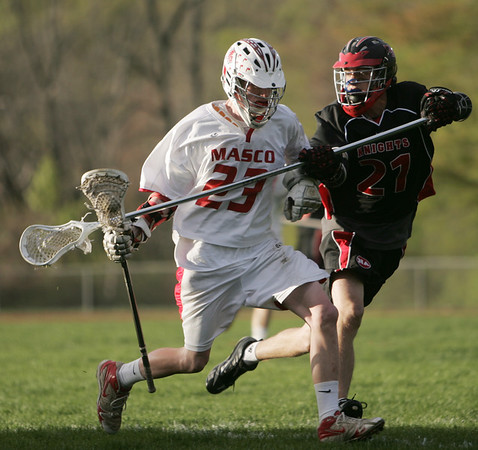 Topsfield: Masco's Mike Broms, left, is slowed down by North Andover defender John Boyle.  Mark Teiwes / Salem News