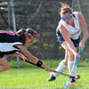 Swampscott:  Swampscott High School field hockey defender Jenn Desmond, right, clears the ball with Salem's Julia Jennings reaching to steal it back.  photo by Mark Teiwes / Salem News