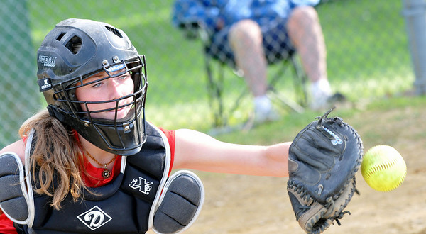 Salem: Tornados catcher Skye Kinnon keeps her eye on the ball as a pitch comes in. Photo by Mark Teiwes / Salem News
