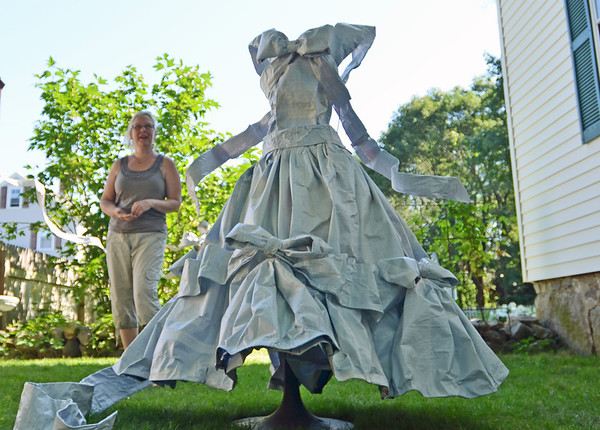 "Hamilton: Artist Jill Herrick-Lee stands with her peice ""Perfect Fairytale"", a dress made from bird seed bags which is part of the ""Art Grows Here"" tour of outdoor art on exhibit through July 24, 2011..  photo by Mark Teiwes / Salem News"