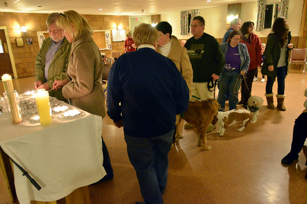 Danvers: The congregation was invited to light a candle in remembrance of companion animals that have died.  As the candles are lit, people named their departed animals.  Beginning December 19th, the church will offer pet loss bereavement support.  photo by Mark Teiwes / Salem News