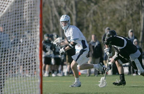 Wenham: Gordon College's Wes Chittick looks to the goal followed by a Nichols defenseman.  photo by Mark Teiwes / Salem News