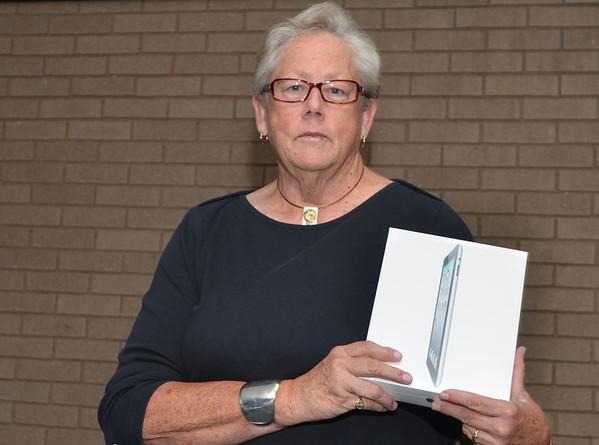 Pat Mulloney won an iPad through an online Qpon contest.  photo by Mark Teiwes  / Salem News