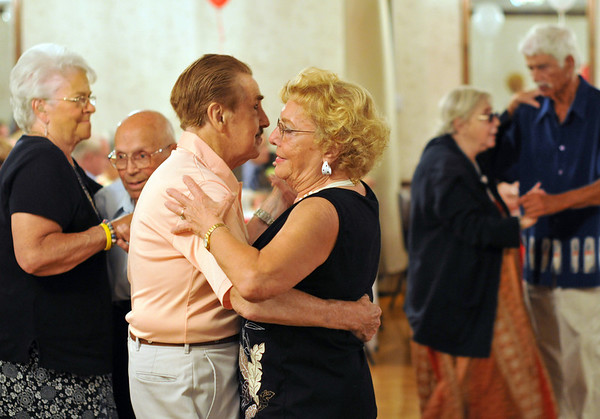Salem: Maurice Evangelista dances with Virginia Lee, both from Peabody, at the Kings of Columbus Hall.  They showed off smooth dance moves they learned at the Wonderland Ballroom. photo by Mark Teiwes / Salem News