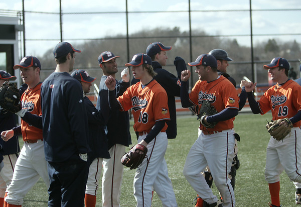 Salem: Salem State baseball team celebrates a successful inning shutting down the Norwich hitters.   photo by Mark Teiwes / Salem News