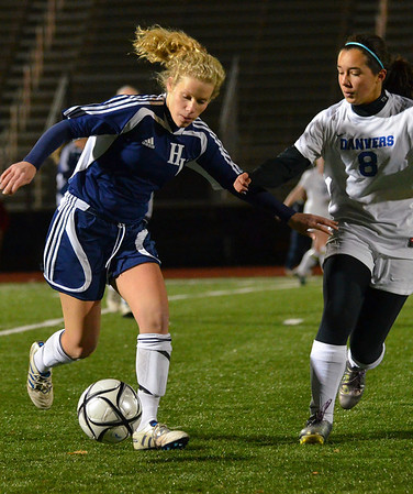 Lynn:  Hamilton-Wenham forward Emily Gaucher, left, carries the ball upfield defended by Danvers' Stephanie Kowalski.  photo by Mark Teiwes / Salem News