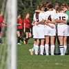 Beverly: Beverly High School girls soccer team comes together before a game against Salem.   photo by Mark Teiwes  / Salem News