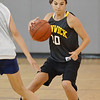 Danvers: Bishop Fenwick's Annette Ruggiero cuts across the court past an Ipswich defender in the North Shore High School Girls Summer Basketball League.  photo by Mark Teiwes / Salem News
