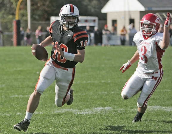 Beverly: Beverly's Dave Rollins, left, scrambles pursued by Masco's Andrew Swimm.  photo by Mark Teiwes / Salem News