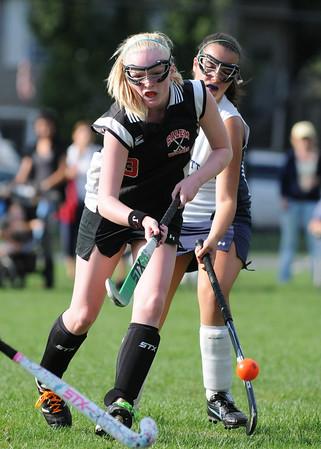 Swampscott: Salem High School field hockey player Sophie Wyke flicks the ball past Swampscott defenders.  Wyke scored a goal in this  opening game of the season.  photo by Mark Teiwes / Salem News