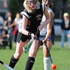 Swampscott: Salem High School field hockey player Sophie Wyke flicks the ball past Swampscott defenders.  Wyke scored a goal in this  opening game of the season.  photo by Mark Teiwes / Salem News