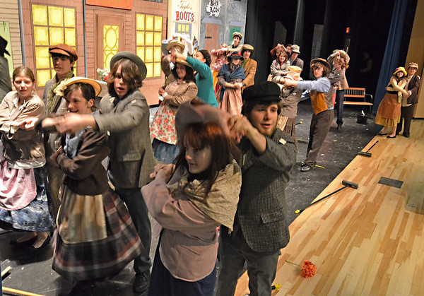 "Beverly: Beverly High School students Adam Constantine, right, spins Devan Imperiali dancing during the song ""Wouldn't It Be Loverly?"" in the musical ""My Fair Lady.""   Opening night is March 10 at 7:00 pm photo by Mark Teiwes / Salem News"