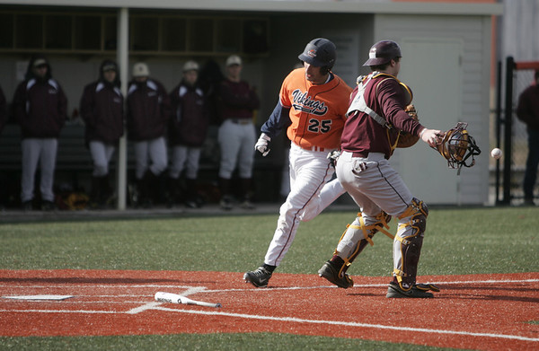 Salem: Salem State's Evan Valcourt beats a throw on his way to home past the Norwich catcher.  photo by Mark Teiwes / Salem News