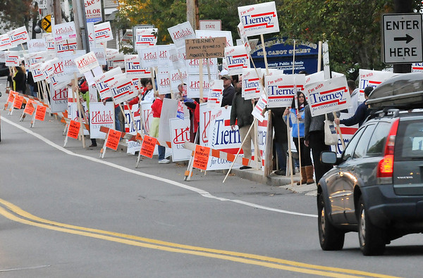 Beverly:  Political signs packed of lined both sides of Cabot St. as fervent Hudak and Tierney supporters showed their enthusiasm.   photo by Mark Teiwes / Salem News