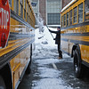 Beverly:  Fred Smuckler, a bus driver with the Beverly public schools, was called in at noon to get the buses ready for the next day of school.  photo by Mark Teiwes / Salem News