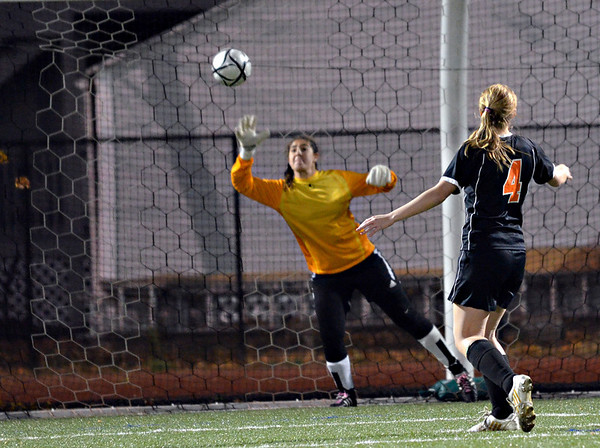 Lynn: Ipswich's Bryn Goleswothy, right, scores the game winning goal against Lynnfield in a shootout. She also scored a goal in the first half.  photo by Mark Teiwes / Salem News