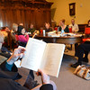 "Peabody:  Patricia Purcell reads the poem ""Diving Into the Wreck,"" by Adrienne Rich during a Tuesday morning poetry workshops for adults at the Peabody Institute Library.  photo by Mark Teiwes / Salem News"