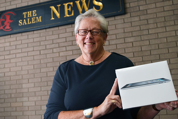 Pat Mulloney won an iPad through an online Qpon contest.  photo by Mark Teiwes  / Salem News