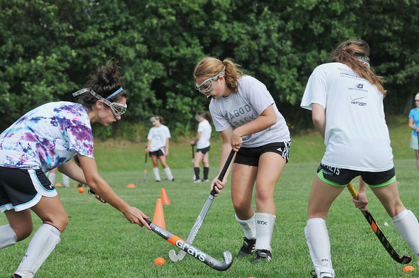 Peabody: Gina Casey, left, and Alaina Warren, both captains, practice with Jenna Sacramone at Peabody High School field hockey practice.  photo by Mark Teiwes / Salem News