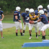 Peabody: Players run through drills at Peabody High School football practice.  photo by Mark Teiwes / Salem News