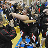 Danvers: Salem girls Jasmine Bryant, left, and  Amanda Wilkins hug celebrating their Division 2 North state tournament playoff win over Danvers.   photo by Mark Teiwes / Salem News