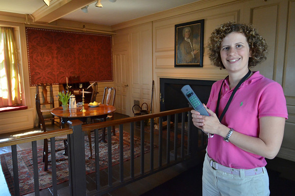 Salem: Amy Waywell, director of visitor services and marketing holds an foreign language audio tour The House of The Seven Gables.  It was made with the help of Salem State students.  photo by Mark Teiwes / Salem News