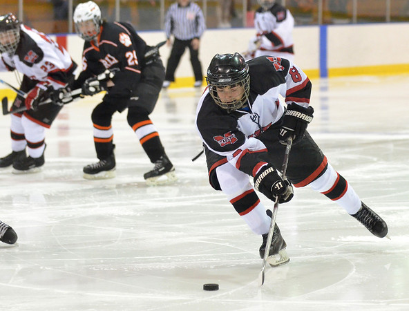 Salem: Marblehead's Aaron DeAngelo puts a back hand shot on goal.  photo by Mark Teiwes  / Salem News