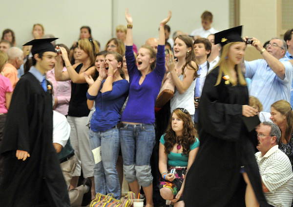 Ipswich: Parents friends and family cheer for the class of 2010 as they receive their diplomas.   photo by Mark Teiwes / Salem News