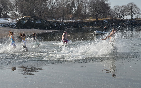 "Salem: Participants plunge into 37 degree water at Dead Horse Beach for the Second annual ""Freeze Your Tush Off"" ocean dip.  They signed a waiver saying, ""...I am aware that this act is not very intelligent...""  photo by Mark Teiwes  / Salem News"