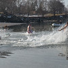"""Salem: Participants plunge into 37 degree water at Dead Horse Beach for the Second annual """"Freeze Your Tush Off"""" ocean dip.  They signed a waiver saying, """"...I am aware that this act is not very intelligent...""""  photo by Mark Teiwes  / Salem News"""