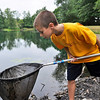 Danvers:  Brian Powers, 12, of Danvers, looks for frogs during a Danvers Recreation Department summer program. photo by Mark Teiwes / Salem News