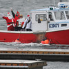 Beverly: Santa arrives at the Ferryway Public Landing in Beverly aboard the Janie M lobster boat. photo by Mark Teiwes / Salem News
