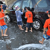Beverly:  9-year-old Beverly East and West little league all-star teams wash cars to raise money for the Jimmy Fund. photo by Mark Teiwes  / Salem News