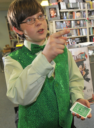 Peabody:  Magician Matthew Barr of Peabody, 12, shows off a card trick at Diamond's Magic Shop.    photo by Mark Teiwes / Salem News
