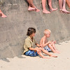 Beverly Farms: Lucas Waugh, left, 9, and Jackson Stacey, 7, watch the final match of the tournament at West Beach.  photo by Mark Teiwes / Salem News
