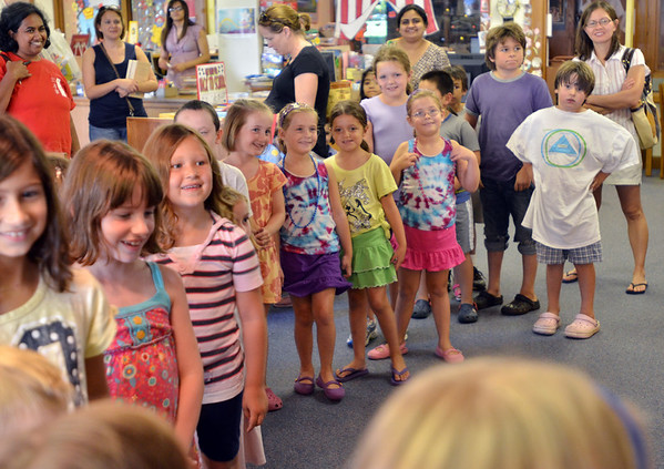 "Salem: Children line up at the beginning of ""Have S'more Summer Fun with Camp Crafts and Stories,"" a children's program at the Salem Public Library.  photo by Mark Teiwes /  Salem News"