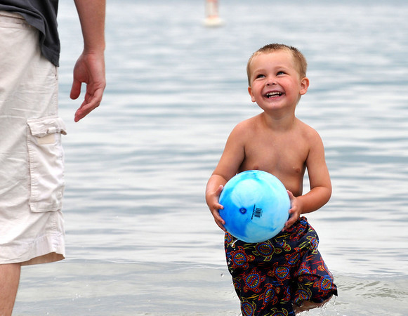 Ipswich: Three year old Flynn Cunningham of Danvers goes knee deep in the cold water at Crane Beach on Memorial Day weekend.  photo by Mark Teiwes / Salem News
