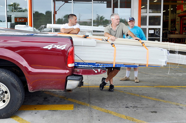 Danvers:   Shawn Mullarkey, left, of Haverhill, his father Michael of Essex, and Charles Russell of Danvers purchased siding for Michael's house on tax-free weekend at Home Depot.  photo by Mark Teiwes / Salem News