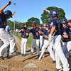 Lynn:  Peabody West  little league player Nick Palmer, left, flies home to celebrate a grand slam against Wyoma.  photo by Mark Teiwes  / Salem News