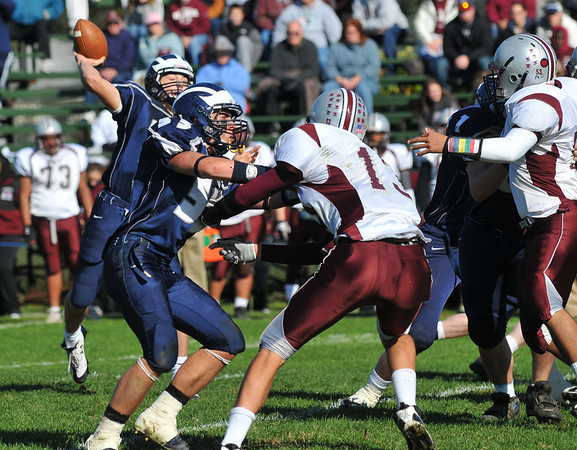 Swampscott: Swampscott's quarterback Michael Walsh sends out a pass on a drive to a touch down.  photo by Mark Teiwes / Salem News