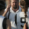 Ipswich: Ipswich girls lacrosse head coach Greg Churchhill talks with his team at halftime.  photo by Mark Teiwes / Salem News