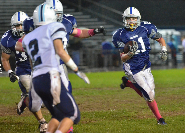 Danvers: Danvers player Alex Valles rushes for some yards.  photo by Mark Teiwes / Salem News