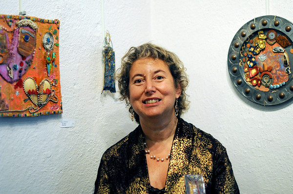 Marblehead: Artist Anne Pofcher of Beverly stands among her multimedia work included in the Three Diverse Women art show.   photo by Mark Teiwes / Salem News