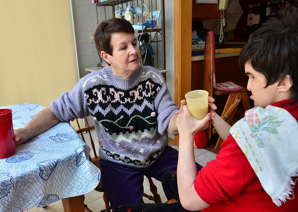 Ipswich:  Vee Zagrobski helps her daughter Heather with a drink.  photo by Mark Teiwes / Salem News