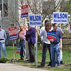 Wenham: Residents holds signs outside of town elections for school committee, selectmen, etc at Buker School. Mark Teiwes / Salem News