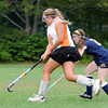 Ipswich: With her eyes set on the goal, Ipswich High School field hockey player Mikhala Reedy, left, flies past Lynfield defender Tara Doherty  photo by Mark Teiwes / Salem News