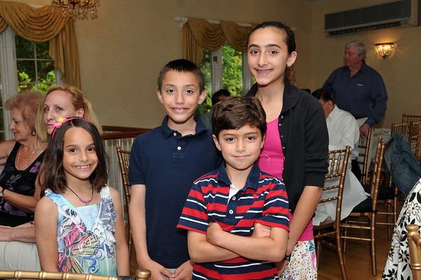 Ipswich: Pictured from left, Alexandra Karafotias, Charlie Karafotias, Christopher Karras, and Katina Karras.  Photo by Mark Teiwes / Salem News